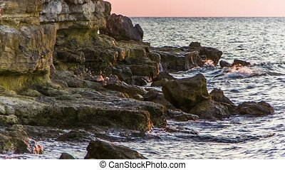 Waves Gently Splashing Against Rocks - Picturesque shot of...