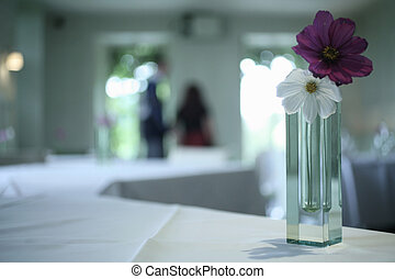 Vase of flowers in wedding banquet party room - Color...
