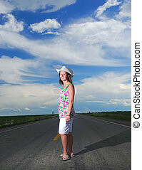 Prairie Girl - A Prairie Girl on highway against a dramatic...