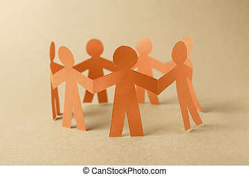 Group of paper chain people - Paper team people linked...
