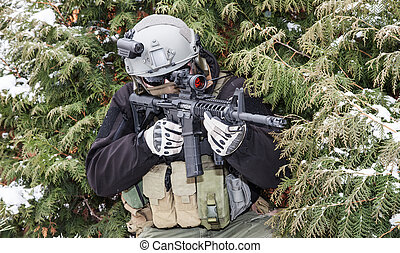 Private military contractor PMC with assault rifle in the...