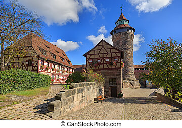Nuremberg Castle (Sinwell tower) with blue sky and clouds,...