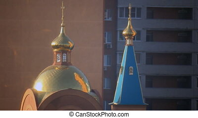 Gold domes - Sunbeams reflect gold dome orthodox church