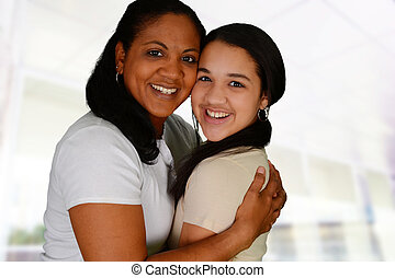 Mother and Daughter - Woman and daughter standing together...