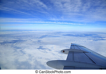 View of airplanes wing from the window, aerial photography