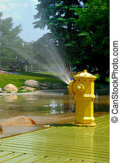 Spraying Fire Hydrant - A refreshing summer spray from fire...