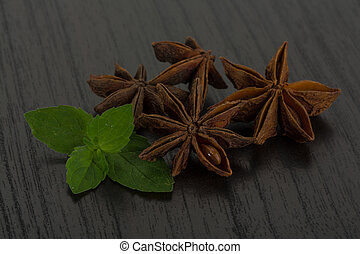 Star anise with mint leaves