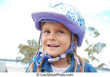 happy girl wearing a helmet - happy 5 year old girl wearing...
