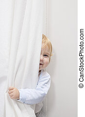baby peeking behind curtain - blonde baby sixteen month old...