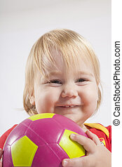 smiling baby with soccer ball - smiling lovely face blonde...