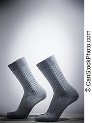Surrealist socks and feet walking without legs attached.