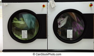 View of automatic washing machines in laundry - Front view...