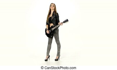 Beautiful young brunette girl with the electric guitar on a white background.