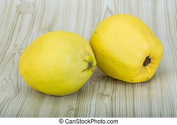 Quince - Fresh ripe Quince on the wooden background