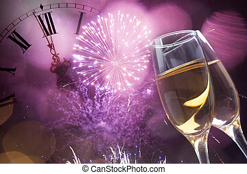 Glasses with champagne and clock close to midnight - Glasses...