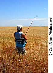 Farmer Fishing inWheat - A farmer with a fishing rod in...