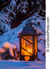 lantern for christmas in the snow - a street lamp glowing in...