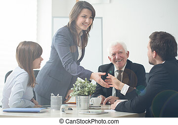 Businesspeople shaking hands - Image of businesspeople...