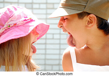 my toungue is longer! - playful kids sticking their tongues...