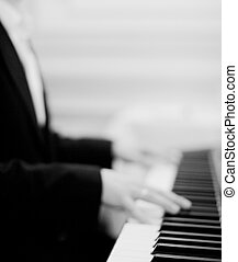 Pianist playing piano in wedding marriage party - Black and...