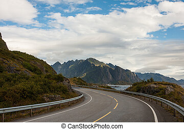 Lofoten road - view of an empty winding road at the Lofoten...