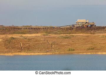 Opencast brown coal mine. Belt conveyor. - Open pit....