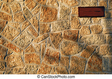 Tyndall Stone Wall Background - A woman sign on a tyndall...