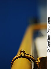 Yellow Pipe - yellow gas pipe against the blue sky