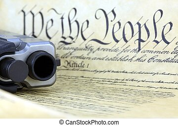 US Constitution with Hand Gun