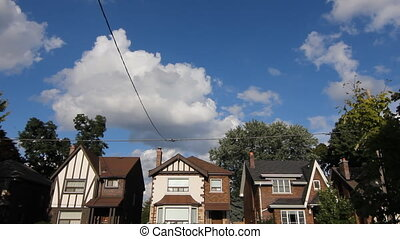 Toronto houses. Timelapse. - Three suburban houses in...