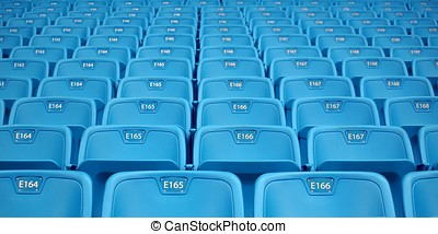 Rows of Emtpy Seats - Hundreds of blue folding chairs in...