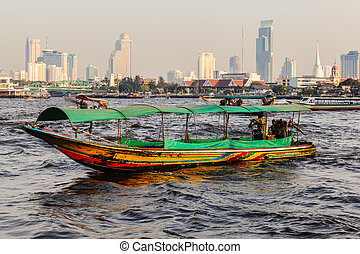 Longtail boat in Bangkok - a thai longtail boat and the...