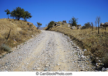 Dirt road - Details of roman aqueduct near dirt road in...