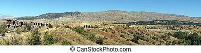 Aqueduct - Roman aqueduct and panorama of farmland in Turkey...