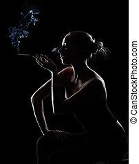 Smoking girl - silhouette of smoking girl on black