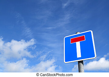 A British no through road T sign and a blue sky