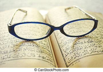 Open book with eyeglasses