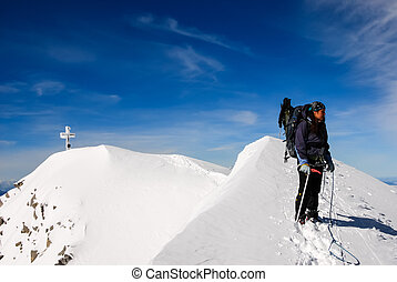 Winter Hiking - A girl at the top of the Muntain....
