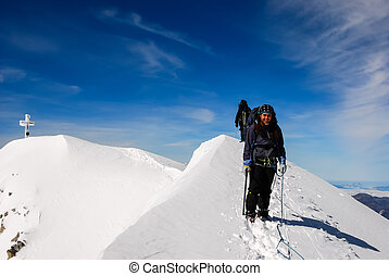Winter Hiking - A girl at the top of the Muntain...