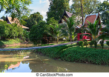 Tropical park with wooden long rope bridge - Tropical park...