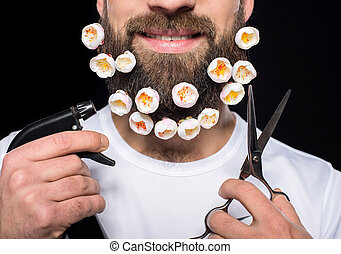 Bearded man - Smiling man with flowers in his beard and...