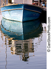 blue reflection - reflected blue boat , Jaffa, Israel