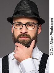 Bearded man - Bearded hipster man wearing hat , suspenders,...
