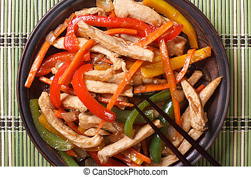 chicken with vegetables macro and chopsticks. horizontal top...
