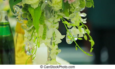 Candles Decorated With Delicate Flowers - Footage from down...
