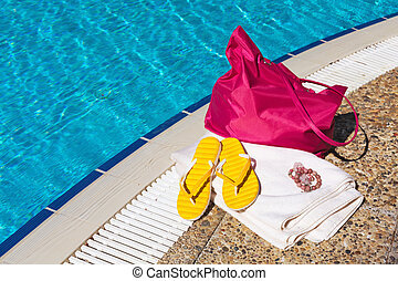 Beach accessories at the pool - Concept of beach accessories...