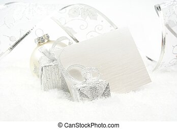 Silver christmas decoration on snow with wishes card -...