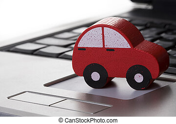 toy car on a laptop - using the internet to find...