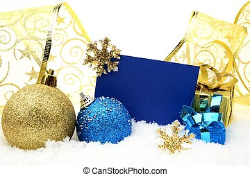 Golden and blue christmas decoration on snow with wishes...