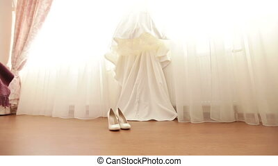 Wedding Dress and shoes - Hanging on windows of expensive...